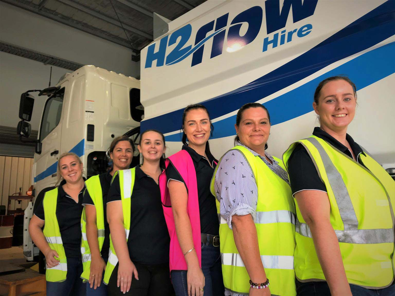 Some of the wonderful women working in customer service, accounts, workshop and driving teams at H2flow Hire.