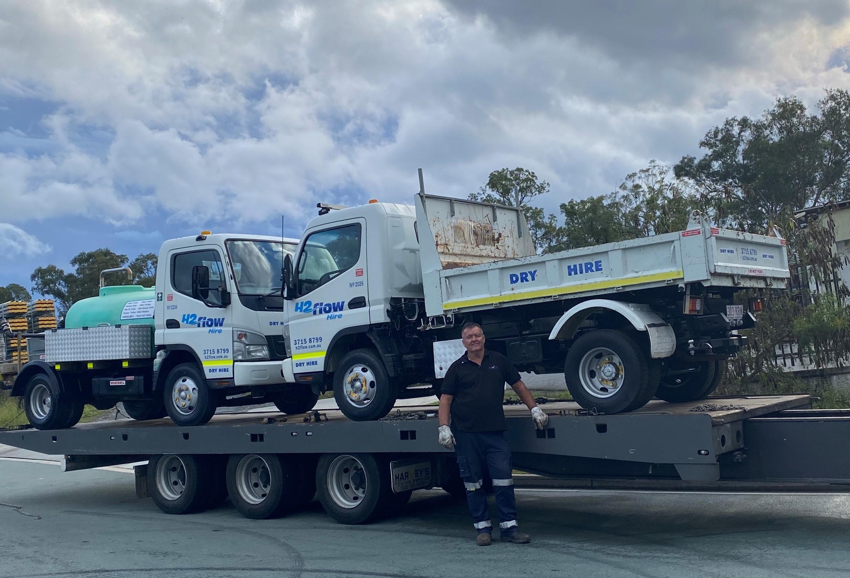 Harvey's Towing boss Joe Andriske ensured safe delivery of H2flow Hire's Mini Trucks.