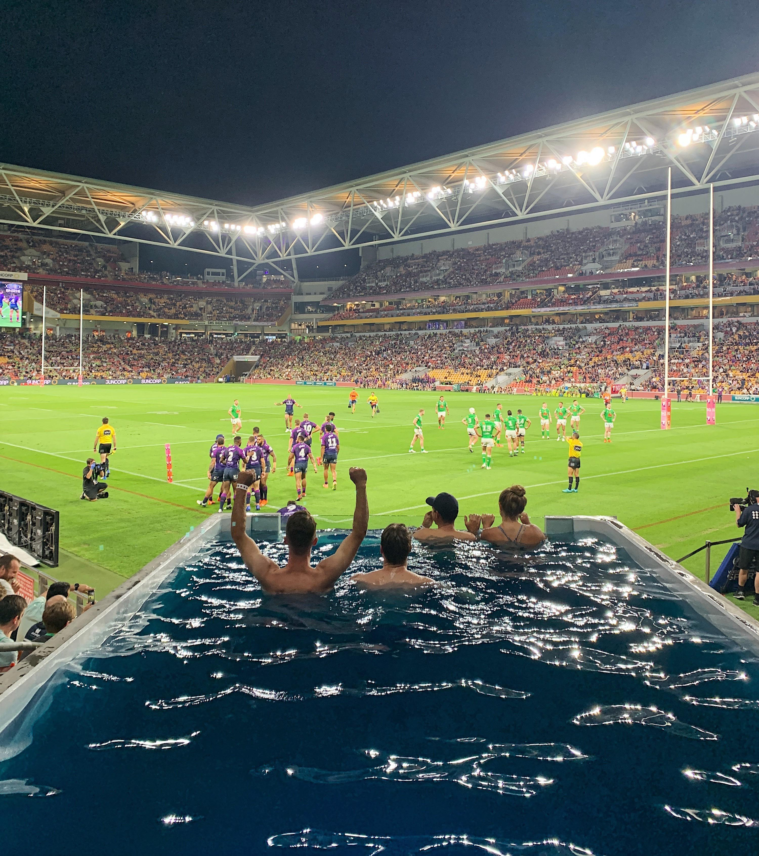 NRL fans in a Plungie pool at the NRL final at Suncorp Stadium.