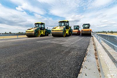 365-Plant-Hire-four-yellow-rollers-Belmont-during-the-day-along-road