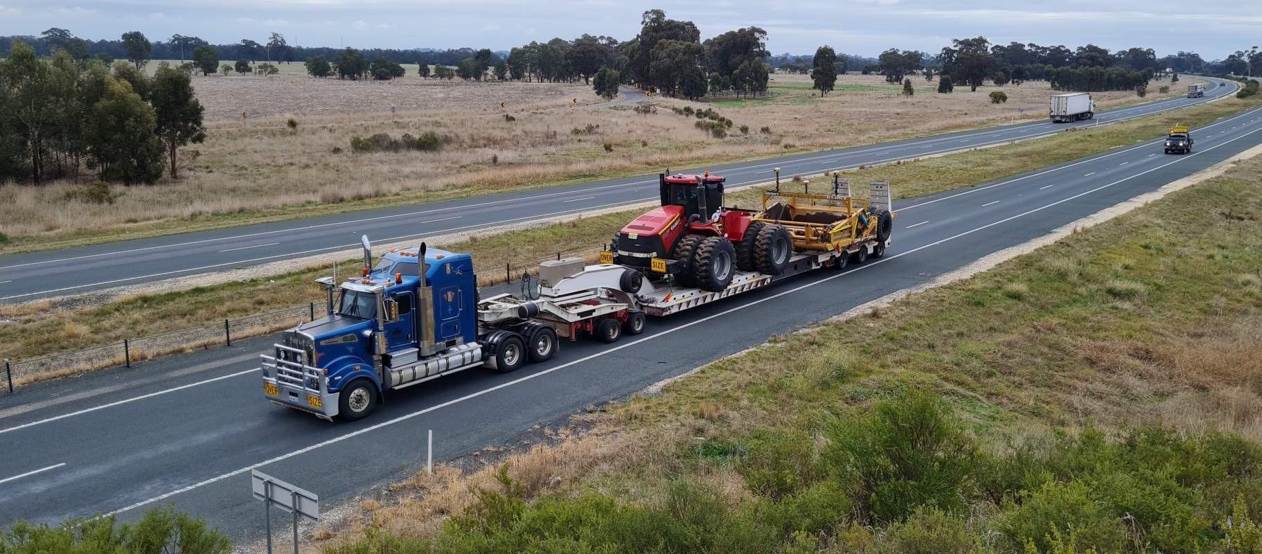 Radeski-Earthmoving-truck-float-grader-Hay