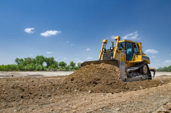 Dozer clearing dirt