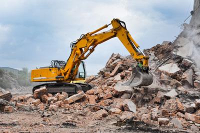 Excavator removing demolition rubble