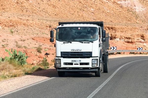 Isuzu rigid hauler travelling on road