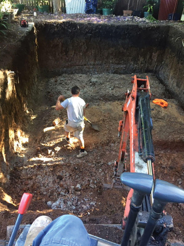 Any-Access-Excavation-and-Demolition-excavator-clearing-debris-Concord