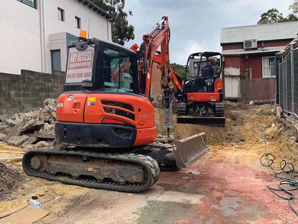 Any-Access-Excavation-and-Demolition-excavator-drilling-on-worksite-Concord