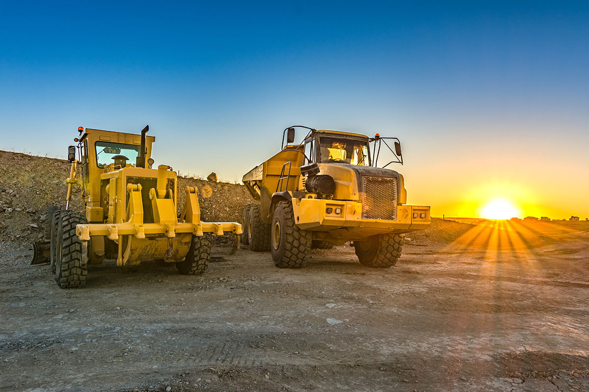 Articulated Dump Truck and Grader