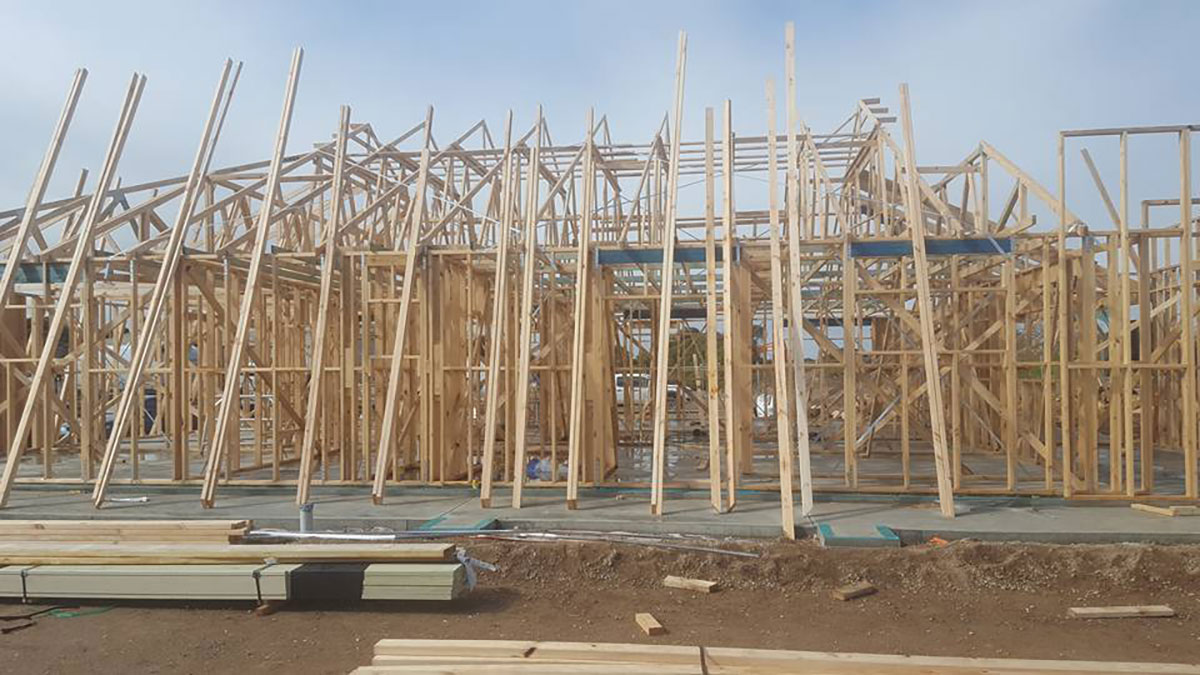 Bennett Plumbing and Civil wooden frame of a building construction project
