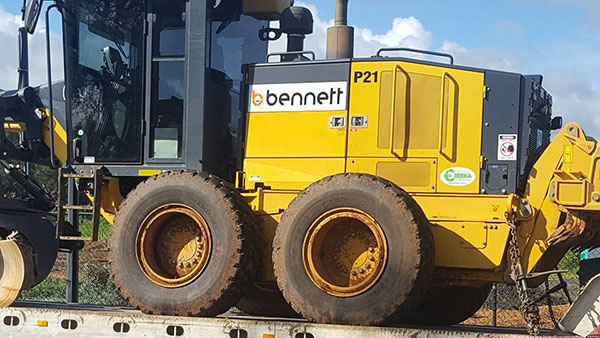 Bennett Plumbing and Civil grader with logo featured