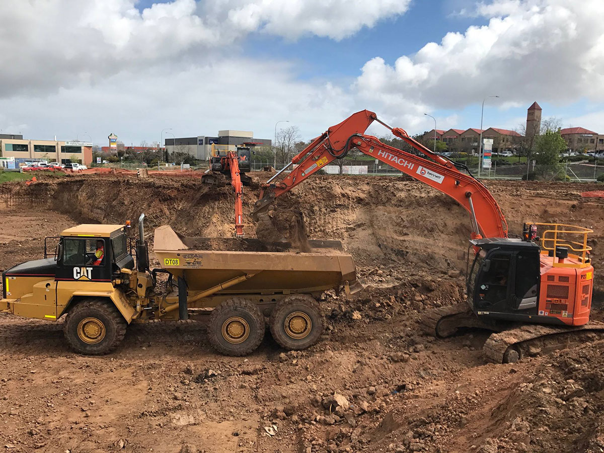 Bennett Plumbing and Civil excavator and truck on site