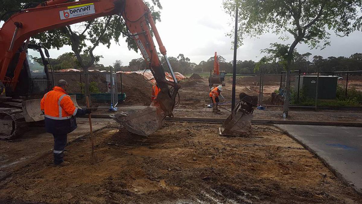 Bennett Plumbing and Civil excavator with interchangeable bucket