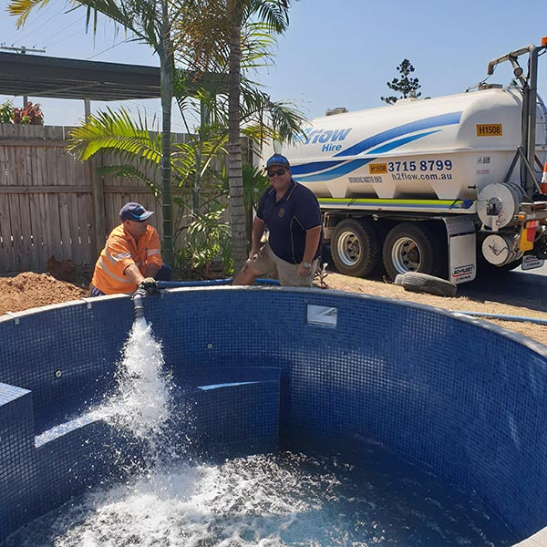 The H2flow Hire team filling up tanks and pools getting ready over summer