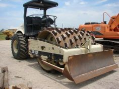 Burns Equipment Group compactor with blade