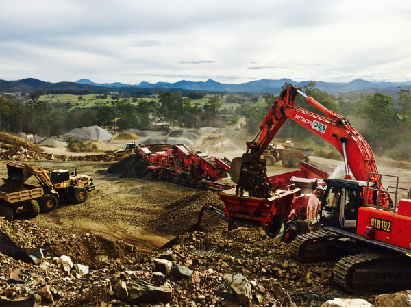 Byrne-Resources-Group-Pacifico-excavator-loading-crusher