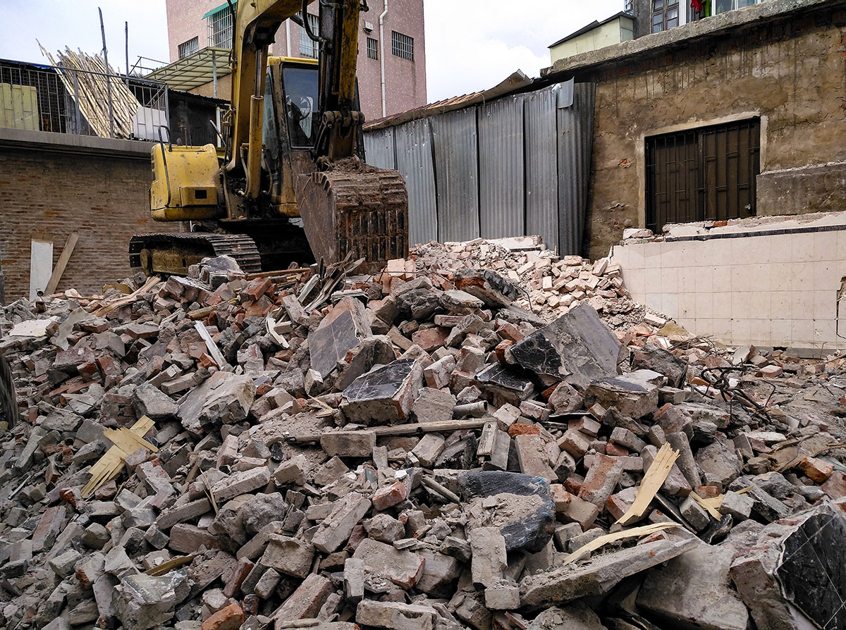 Excavator on building waste