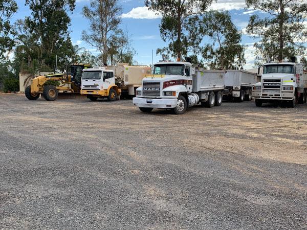 Grader, water carts and tipper trucks