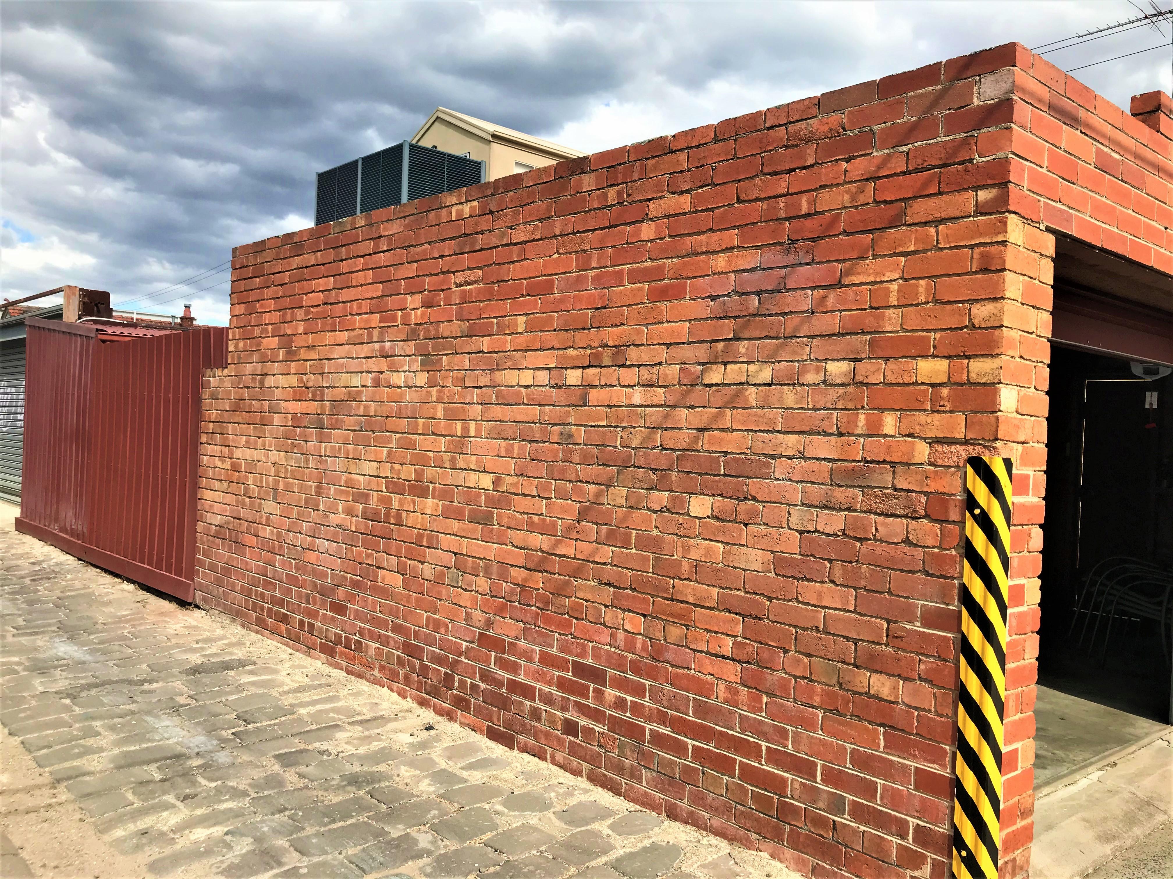 Graffiti removal work on a Brunswick heritage home