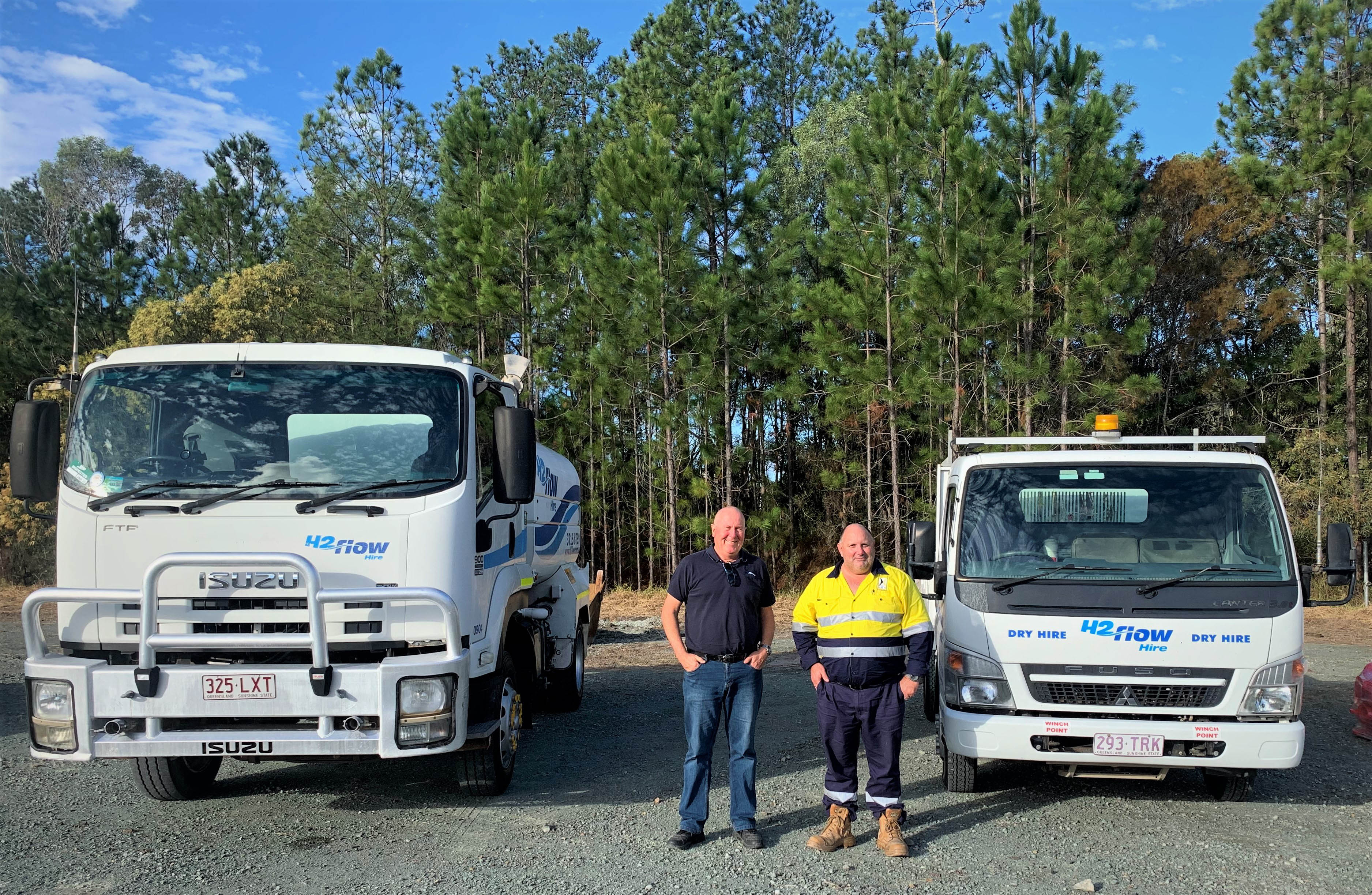 Director Scott Beioley with HEH Civil Site Supervisor with a H2flow Hire water truck and tipper.