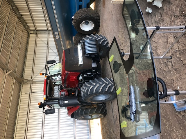 Tracked tractor glass replacement
