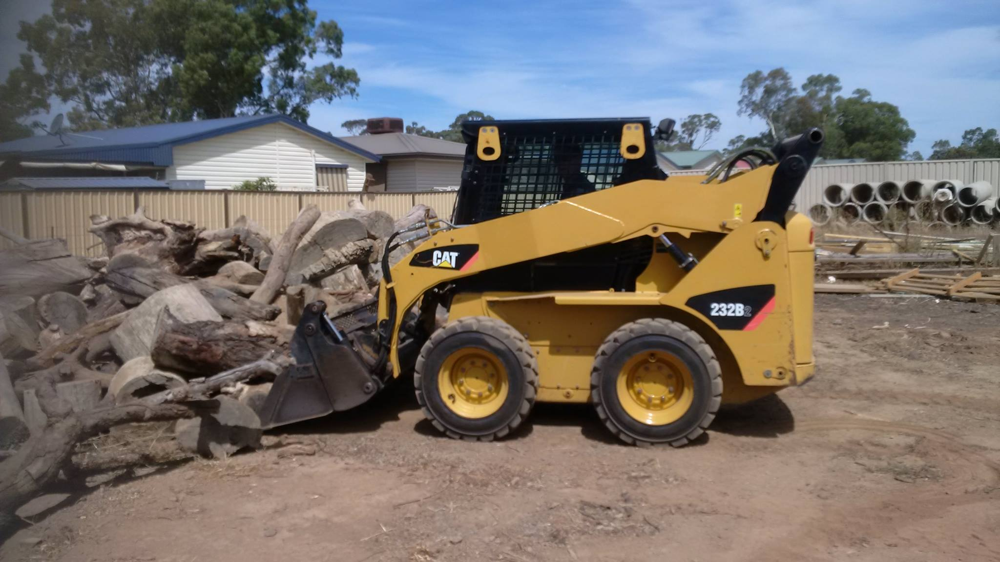Hume Hire CAT Bobcat site cleaning