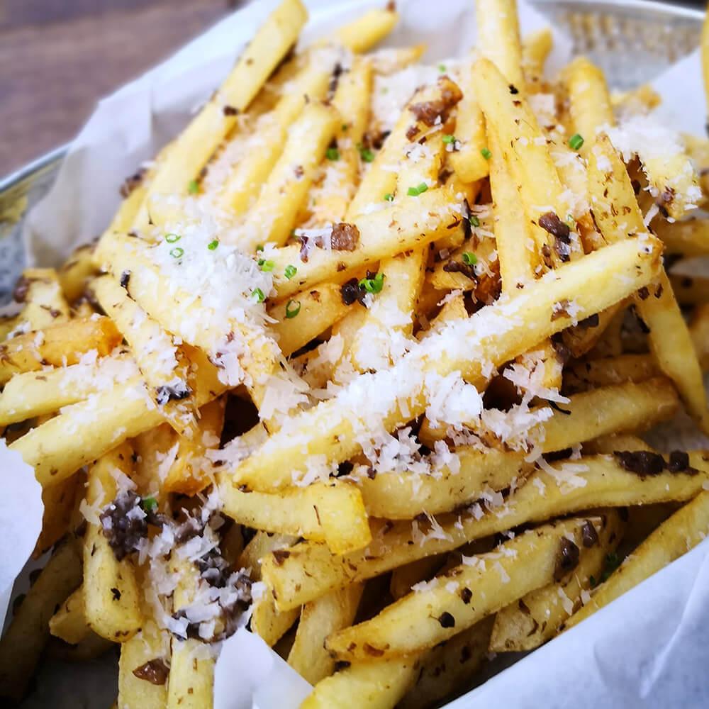 Truffle Fries in Bar.Celona, Singapore. The best pairing for Brut Cava
