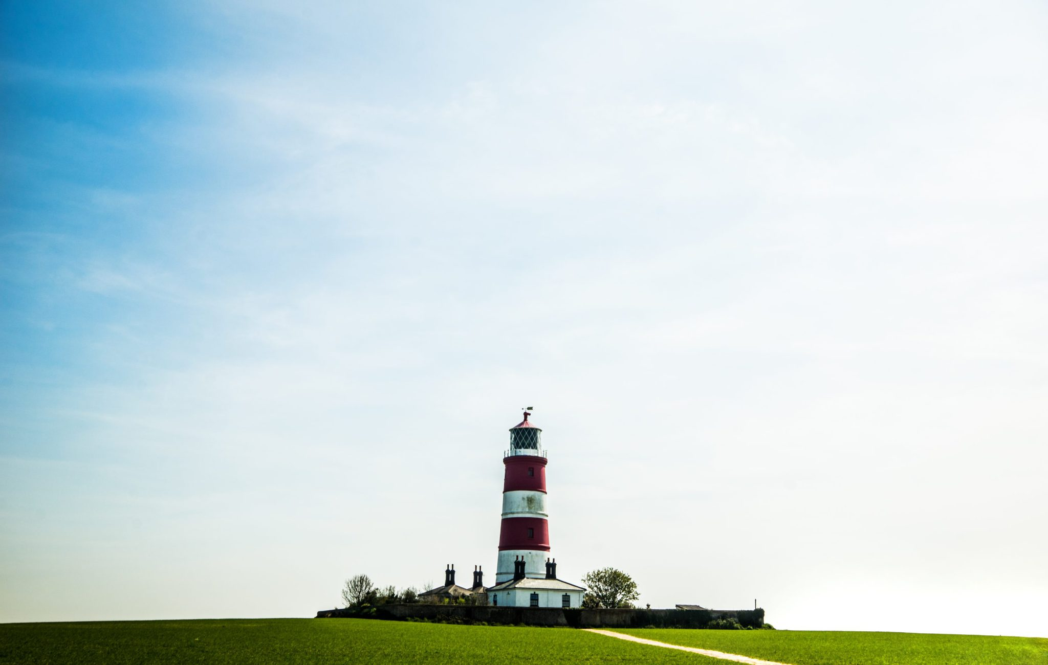 Creative lighthouse photography captured at Happisburgh beach, Norfolk
