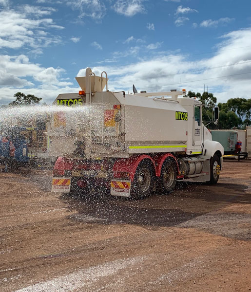 Water truck being washed