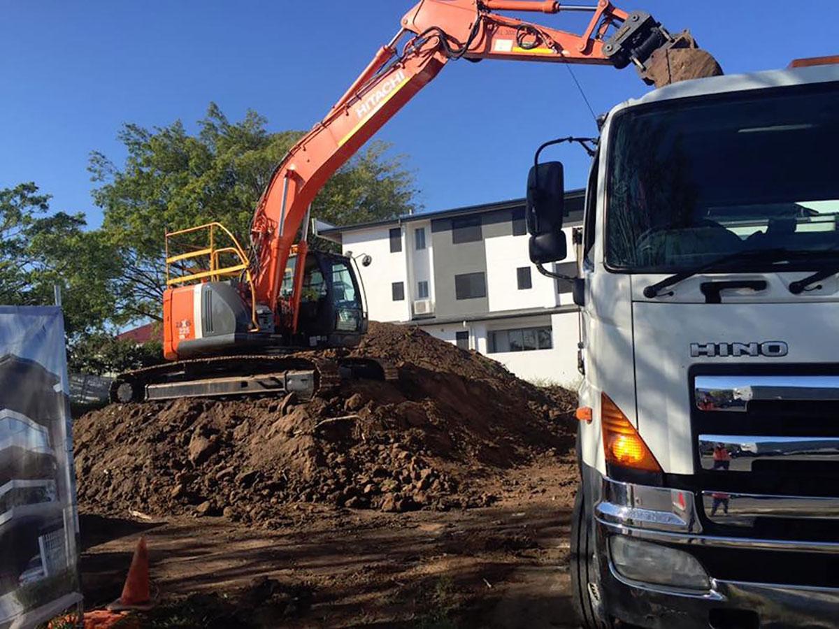Mcmanaway_Earthmoving hino truck excavator.jpg