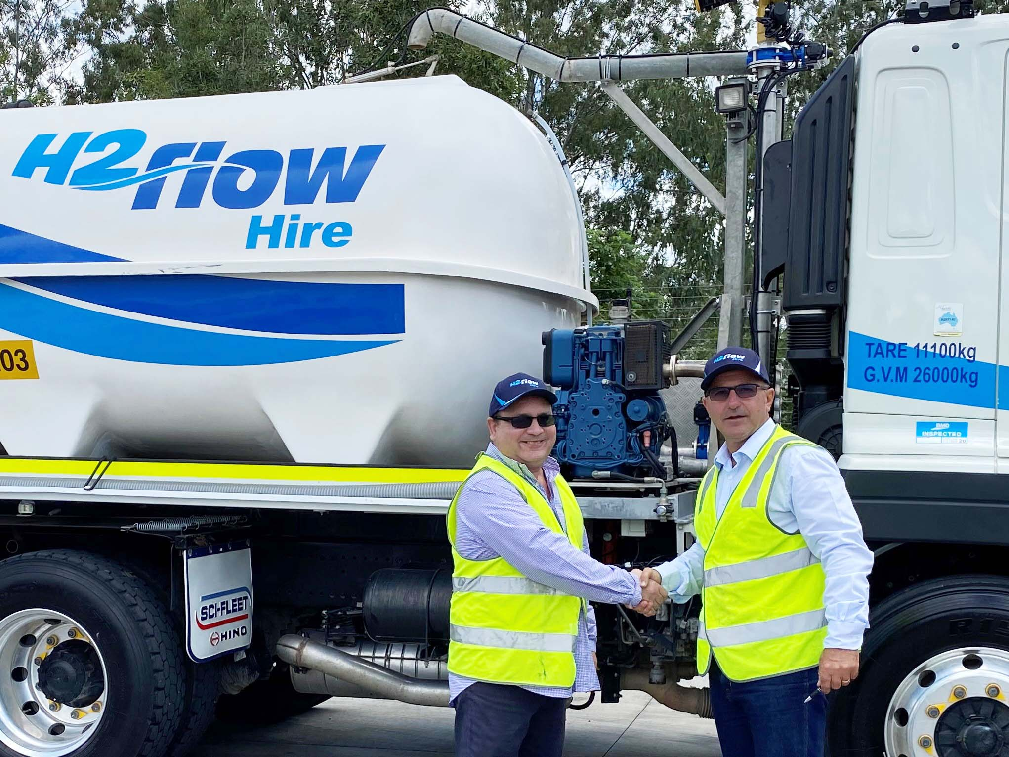 Paul Paulson from Nahri and H2flow Hire Director Mark Broekman in front of a H2flow Hire water truck.