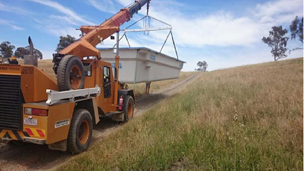 National-Cranes-and-Engineering-franna-transport-material-bin-services