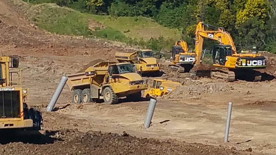 OCON Services machine dump truck excavator on site