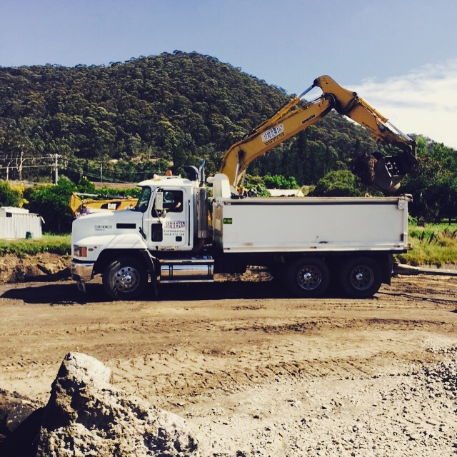 Peters Earthmoving Excavator and tipper comobo on site