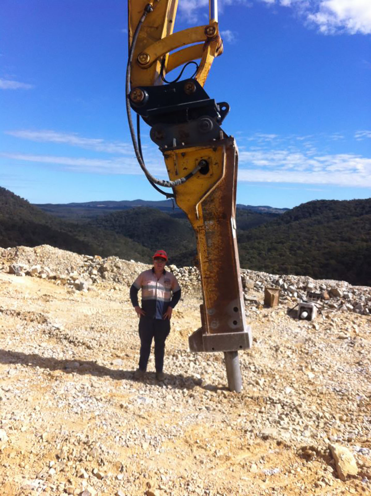 Peters Earthmoving operator standing next to rock hammer