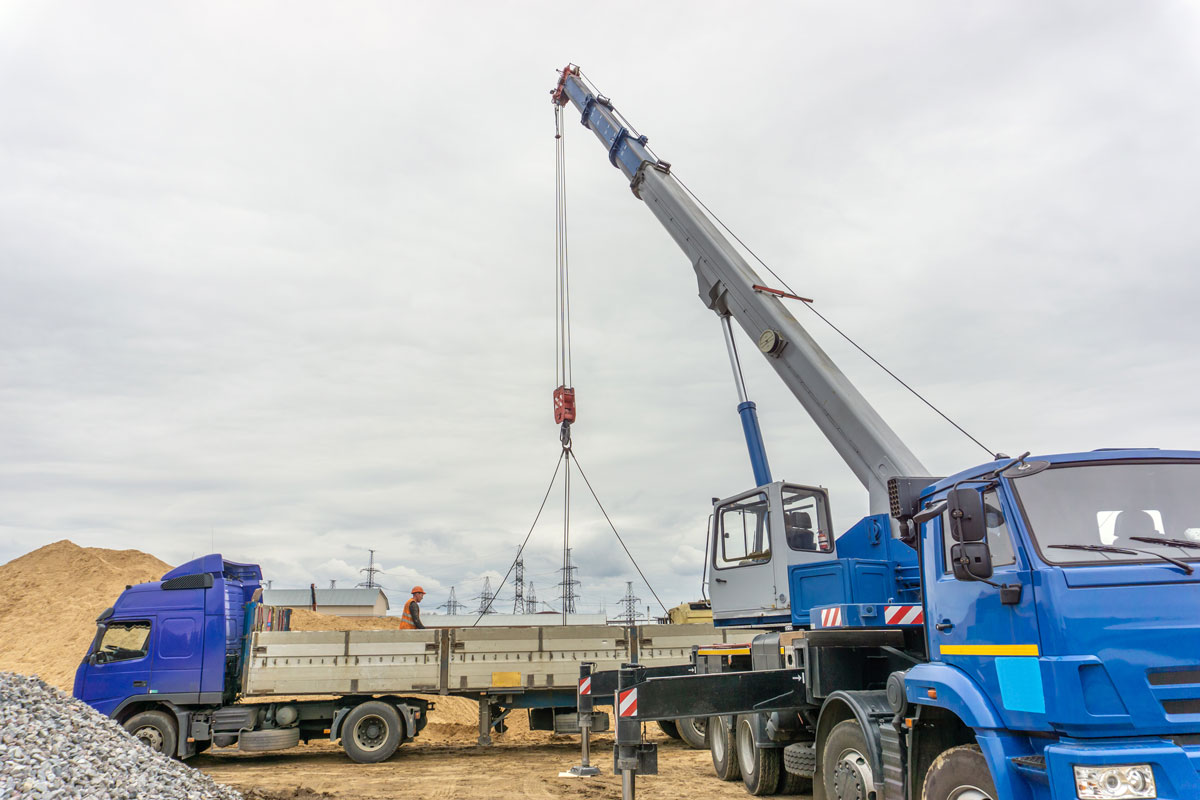 plant-shift-heavy-haulage-crane loading onto low loader