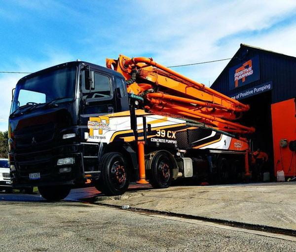 Black and orange Junjin line pump truck