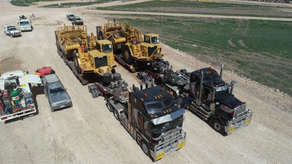 Trucks and scrapers
