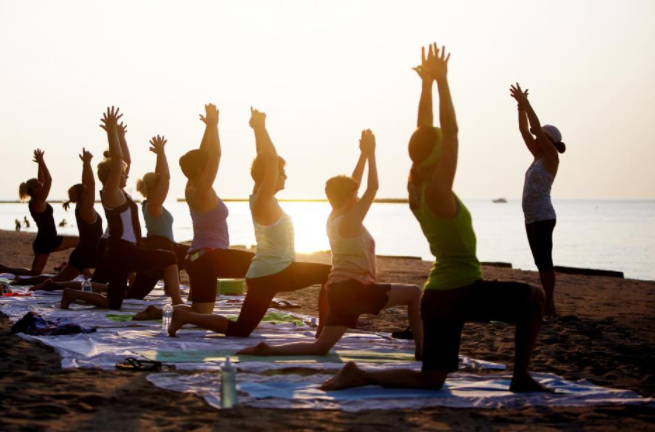 Summer sunset yoga on Suffolk beach
