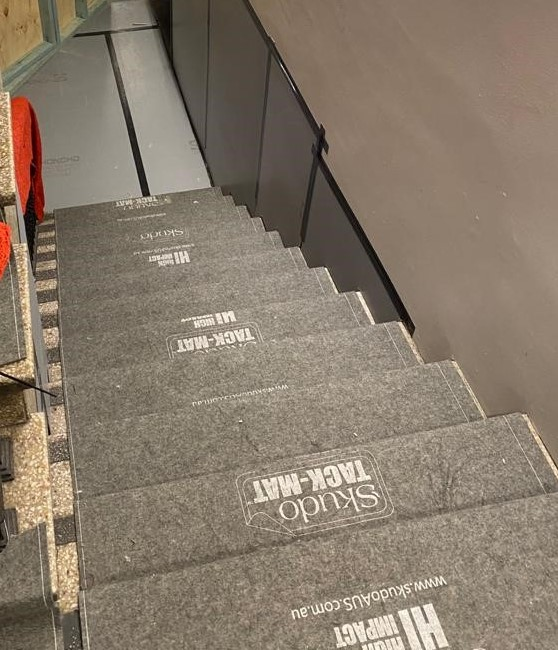 Skudo HI Tack-Mat protecting heritage stairs during an office renovation