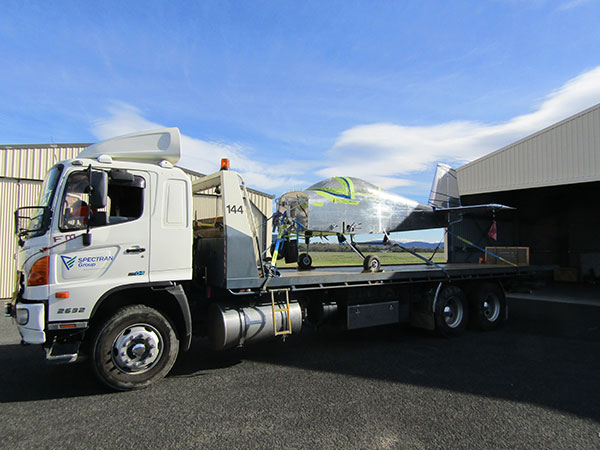 Spectran-Group-Plane-on-Flat-Bed-Truck-Hobart