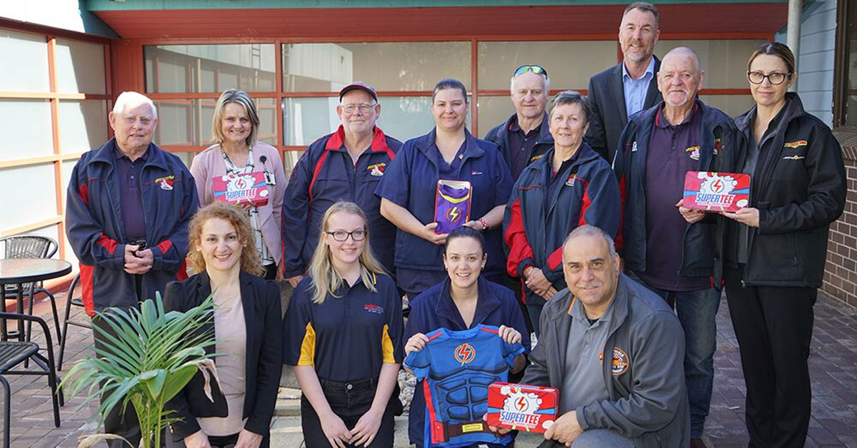 Alannah from Online Hire joins The Lions Pride Holden Car Club and other sponsors, presenting SuperTee's to Nepean Hospital