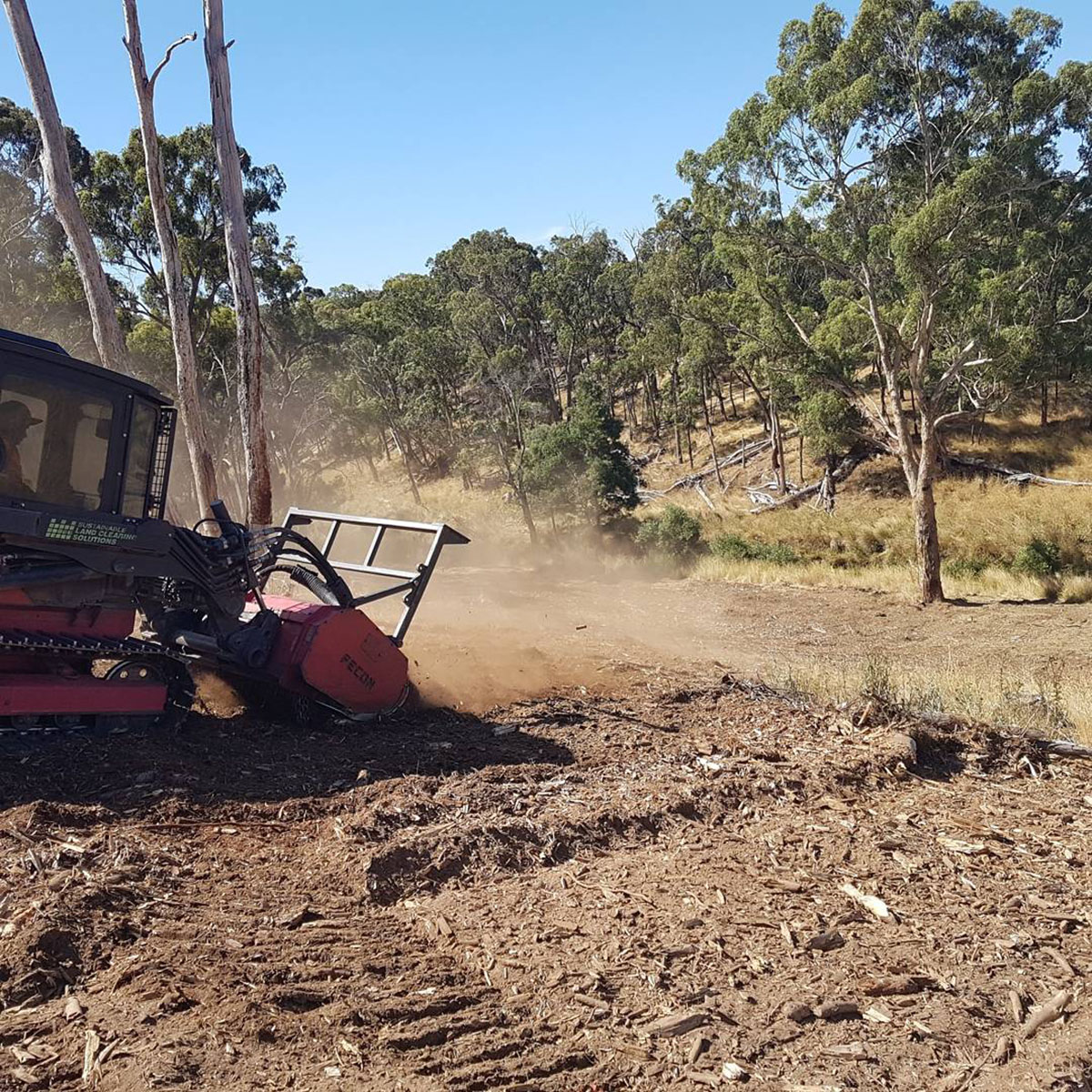 Sustainable Land Clearing Solutions chipper on clearing site dust