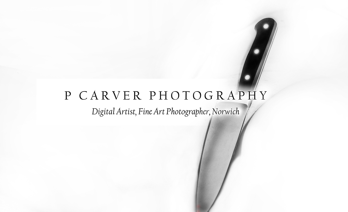 A black and white photograph of a kitchen knife by Norwich based photographer P Carver