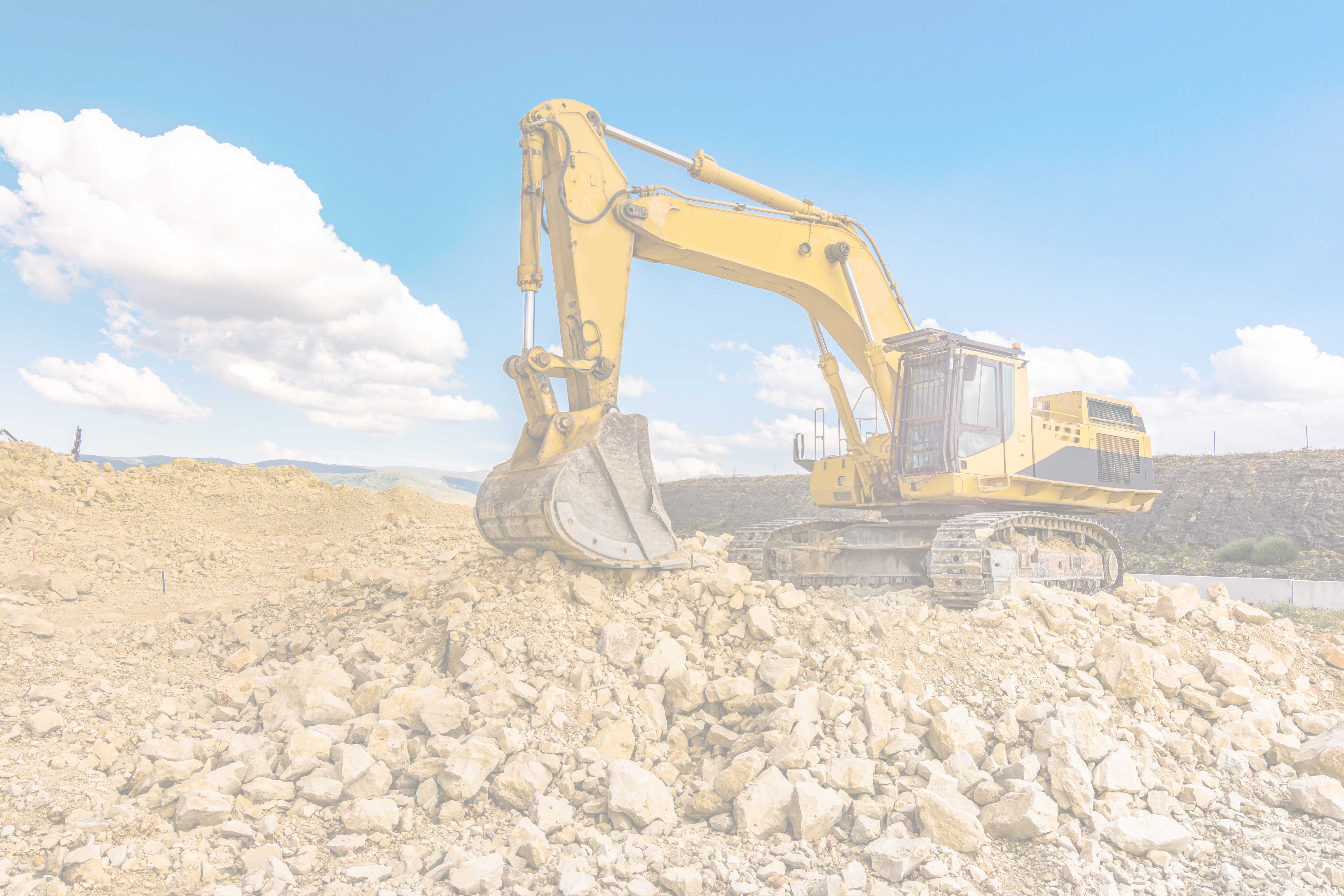WO Excavator - quarrying - on gravel heap-min