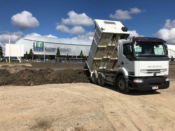 Ausquip-road-truck-hire-gold-coast-tipper-truck-in-front-of-stadium