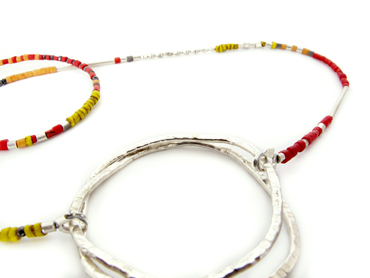 Silver beaten circle claps on beads by Robyn Wernicke