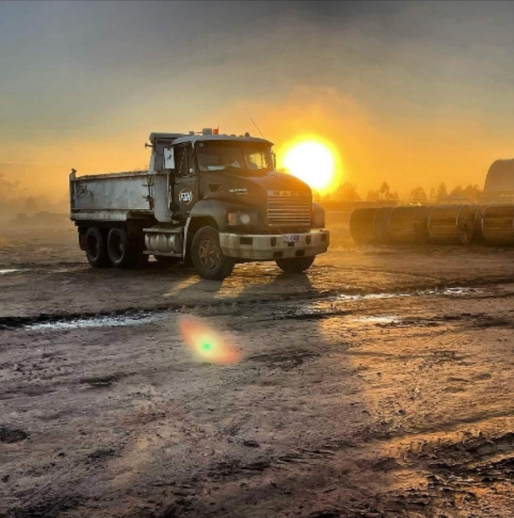 Grader and tipper trucks