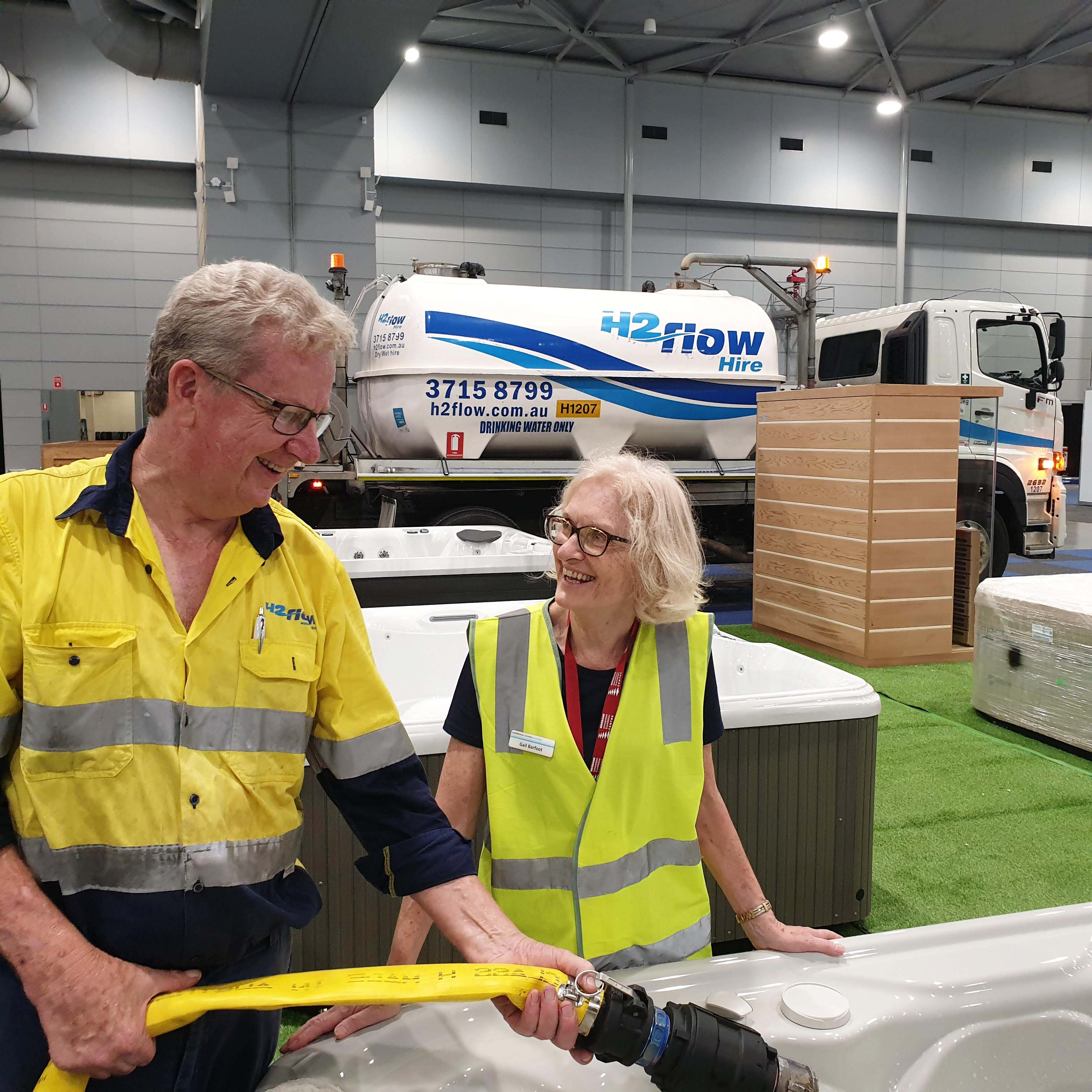 H2flow Hire driver, Wayne Clucas, filling spas for the Brisbane Spa Super Centre display at the Brisbane Home Show.