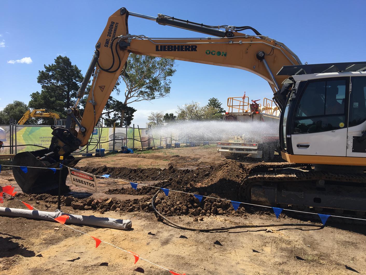 OCON Services bulk material excavator loader
