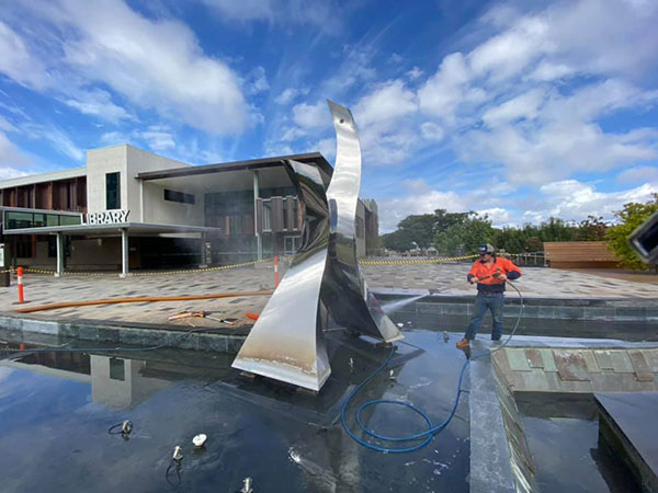 Ezali Hydro Excavations & Communications hydrovac services jet hosing statue at library