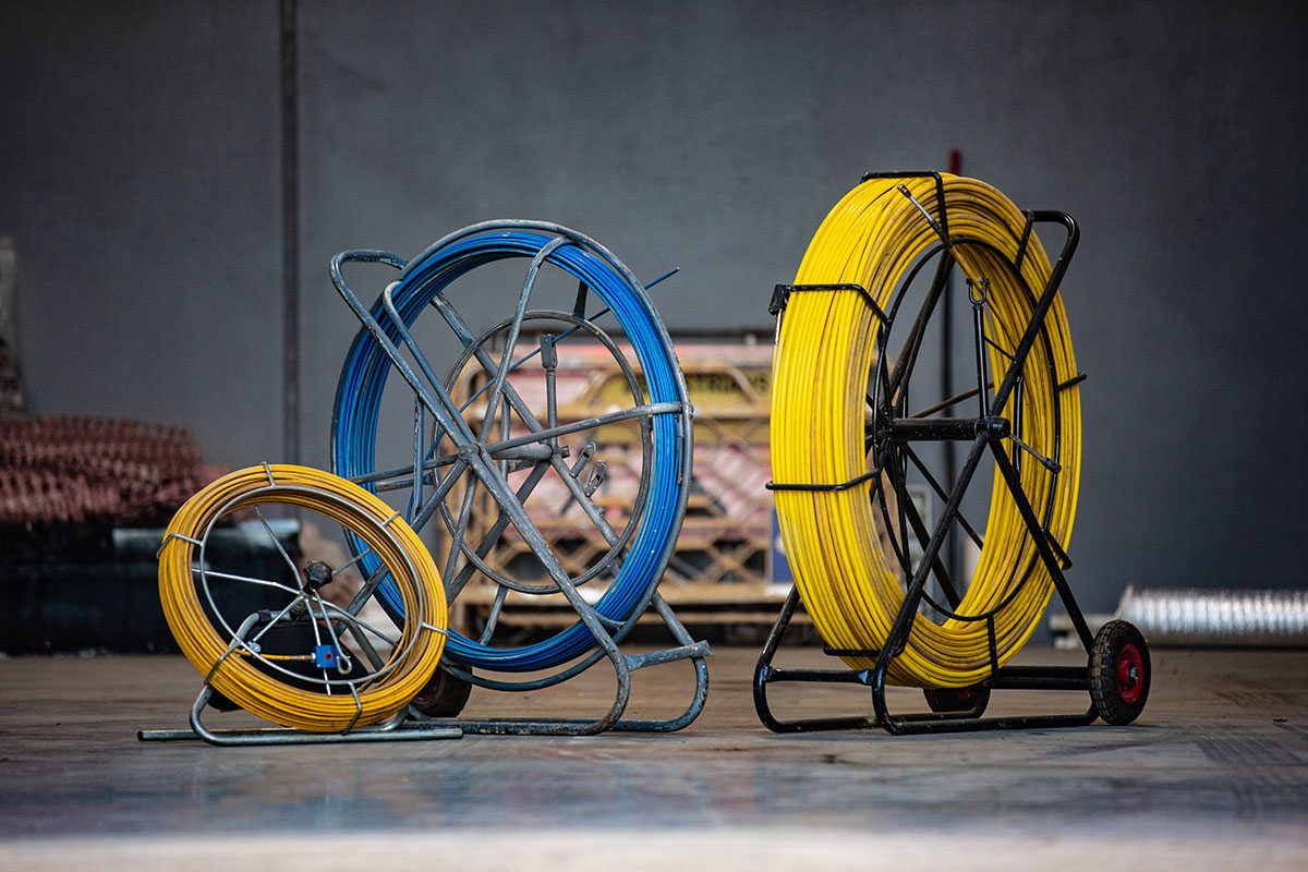Yellow and Blue Jetting & Drain Cleaning Hoses in Hoops